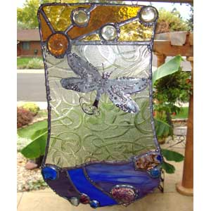 stained glass with dragonfly
